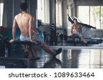 fitness man with dumbbell tired ... | Shutterstock . vector #1089633464