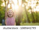 pretty little girl shows heart... | Shutterstock . vector #1089641795