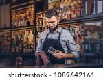 stylish brutal barman is... | Shutterstock . vector #1089642161