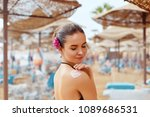 woman smile applying sunscreen... | Shutterstock . vector #1089686531