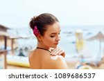 a female  applying sun cream ... | Shutterstock . vector #1089686537