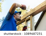man is building a wooden house... | Shutterstock . vector #1089687251