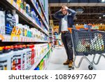 man can't decide in store what... | Shutterstock . vector #1089697607