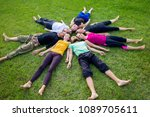 a group of people lies on a... | Shutterstock . vector #1089705611