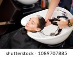 beautiful brunette washes hair... | Shutterstock . vector #1089707885