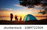 family resting with tent in... | Shutterstock . vector #1089722504