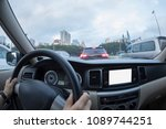 driving car on city street   | Shutterstock . vector #1089744251