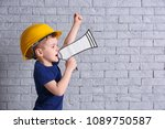 adorable little boy in hardhat... | Shutterstock . vector #1089750587