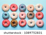 delicious glazed doughnuts on... | Shutterstock . vector #1089752831