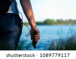 the guy is holding a portable...   Shutterstock . vector #1089779117