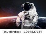 astronaut at the spacewalk.... | Shutterstock . vector #1089827159