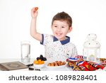 happy young muslim boy holding... | Shutterstock . vector #1089828401