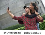 joyful interracial couple is... | Shutterstock . vector #1089830639