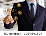 businessman hand touching ico ... | Shutterstock . vector #1089841529