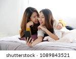young cute asia woman lesbian... | Shutterstock . vector #1089843521
