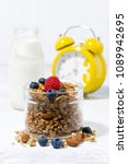 homemade muesli in a glass jar... | Shutterstock . vector #1089942695