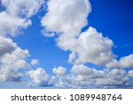 white clouds hanging from blue... | Shutterstock . vector #1089948764