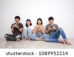 asian people using smartphone...   Shutterstock . vector #1089952214