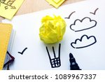 Stock photo yellow paper in form of air balloon as dreams concept procrastination or vacation 1089967337