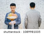 gay couple holding a bouquet of ... | Shutterstock . vector #1089981035