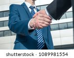 asian business people shaking... | Shutterstock . vector #1089981554