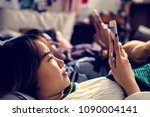 teenage girls using smartphones ... | Shutterstock . vector #1090004141