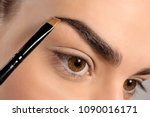 young woman correcting eyebrow... | Shutterstock . vector #1090016171
