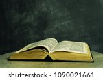 bible on a round white table.... | Shutterstock . vector #1090021661