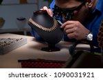 jeweler working in his workshop ... | Shutterstock . vector #1090031921