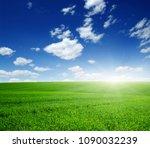 green field  blue sky and sun.  | Shutterstock . vector #1090032239