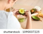 woman making nourishing mask... | Shutterstock . vector #1090037225