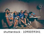group of young friends watching ... | Shutterstock . vector #1090059341