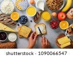 female hands spreading butter... | Shutterstock . vector #1090066547