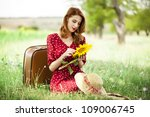 Redhead girl with sunflower at outdoor. - stock photo