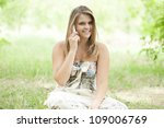 Teen girl in the park. - stock photo