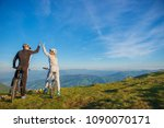 happy couple goes on a mountain ...   Shutterstock . vector #1090070171