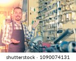 young male worker showing his... | Shutterstock . vector #1090074131