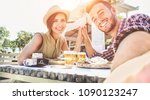 handsome couple taking selfie... | Shutterstock . vector #1090123247