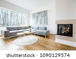 wooden table on a round rug...   Shutterstock . vector #1090129574