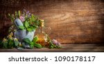 herbs stone mortar and oil... | Shutterstock . vector #1090178117