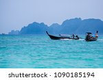 fisherman boat and rocky island ...   Shutterstock . vector #1090185194