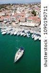 Small photo of Aegina island, Attica / Greece - May 12 2018: Aerial photo from iconic port of Aegina island with yachts and sail boats docked and traditional character, Saronic gulf