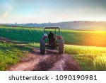 a farmer in his tractor passes... | Shutterstock . vector #1090190981