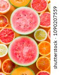 Small photo of Citrus background, wallpaper with citrus orange lemon and grapefruit around two half of watermelon