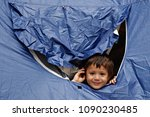 Small photo of A Refugee boy sits in tent in Victoria Square, where migrants and refugees stay temporarily in Athens, Greece on Sep. 22, 2015.