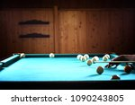 Small photo of Party in 12-foot pool. Billiards in the club game for men.