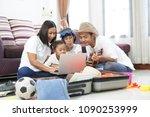 happy asian family on a floor... | Shutterstock . vector #1090253999