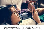 teenage girls using smartphones ... | Shutterstock . vector #1090256711