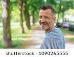 portrait of smiling mature man... | Shutterstock . vector #1090265555