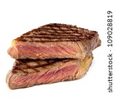 Grilled sirloin steak, cut in half, isolated on white. - stock photo